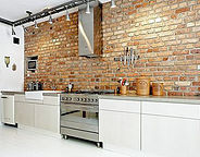 White Kitchen cabinets with brick backsplash